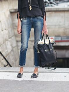 Like the combination of loose top with fitted but distressed jeans