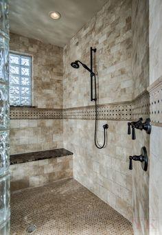 Y K Stone Center - Denver, CO, United States. walk-in shower, natural stone tiles, travertine tiles set subway style, travertine mosaic floor tiles, emperador dark marble shower bench.