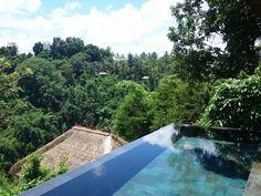 Swim in the award-winning infinity pools of the 5-star Hanging Gardens Ubud in Bali's rainforest.