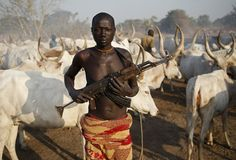 A man from Dinka tribe holds his AK-47 rifle in a Dinka cattle herders' camp near Rumbek in central South Sudan. Reuters