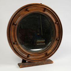 Lot 392 - Heals Oak circular mirror, circa 1920 43cm diameter.