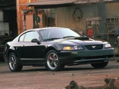 Profile: The 2001 Ford Bullitt Mustang: The 2001 Bullitt was a sleek racer, available in a Dark Highland Green Exterior, just like McQueen's 1968 counterpart.