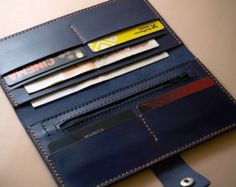 This is 100% handmade leather long wallet that allows to store any bills (dollars, euros etc.), cards, coin, some phones, and other papers, like bills