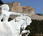 """A scale model of Korczak's monument to Crazy Horse shows how the nonprofit humanitarian project will look when it's completed in """"mountain scale""""."""