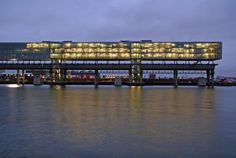 Office buildings on top of a former craneway in Amsterdam: Κraanspoor/ OTH