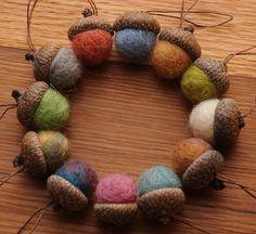 I love this wreath! felt balls in real acorns