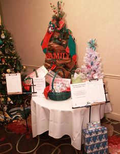 Family Time Tree by Kris Carlson included games and puzzles. White Fiber-Optic Tea Around the Christmas Tree decorated by Kathy Miller and included TeaLightful Teas Leukemia And Lymphoma Society, Christmas Tree Decorations, Table Decorations, Fiber Optic, How To Raise Money, Teas, Puzzles, Games, Puzzle