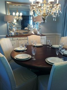 Love dark round dining tables