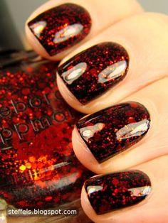 Dark red sparkle nails. I'm not really big on red, but these are cute!