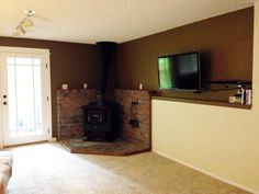 Pan over to the wood stove corner of the basement family room. Great daylight room!