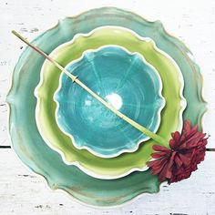 Flower from the garden flowers from the studio. This is a large nesting bowl set in Organic Soul. by leewolfepottery