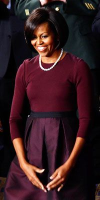 """Mrs. Obama may have thrilled onlookers in her deep cranberry dress, but no one was more pleased by the First Lady's appearance then the ensemble's designer, Isaac Mizrahi. """"Forget the dress, the new bob is divine,"""" gushed the ecstatic Mizrahi on his video blog, before conceding, """"Plus, the dress was pretty good, I must say."""""""