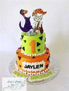 Buttercream iced Bam Bam Flintstone birthday cake. Topper hand colored on gumpaste.