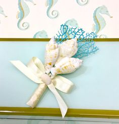 Beach Wedding Seashell Boutonniere with Natural Sea Fan - Choose from 24 Ribbon Colors - Lapel Pin Nautical Sea Shell by SeashellCollection on Etsy https://www.etsy.com/listing/175623652/beach-wedding-seashell-boutonniere-with