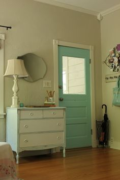 two tone dresser with pale aqua on outside and white drawer fronts.