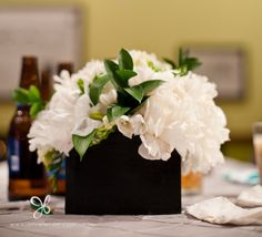 White peonies mixed with gree foliage look fabulous in these square black vases on the wedding reception tables. Peonies Wedding Centerpieces, White Flower Centerpieces, Peonies Centerpiece, Centrepieces, Centerpiece Ideas, Square Wedding Tables, Wedding Reception Tables, Pink Wedding Theme, White Wedding Flowers