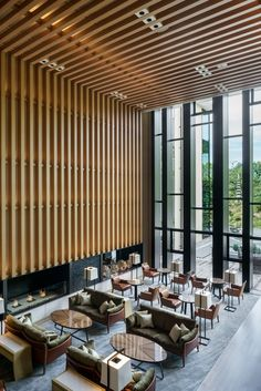 ©Seth Powers. Archdaily -  Brasserie Restaurant at Four Seasons Hotel Kyoto, designed by Kokaistudios