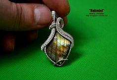 Wire Wrap Pendant out of fine silver 925. Natural Stone Labradorite
