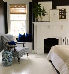 New black bedroom color with painted white wood floors. William Rankin McLure IV