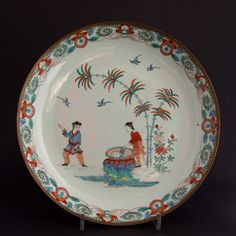 An Early 18th Century Chinese Export Porcelain Saucer Shaped Dish, Late Kangxi or Yongzheng c.1700-1730. Decorated in Holland with the Kakiemon Style `Hob-in-the-Well` Pattern c.1720-1730. The Rim Bound in Bronze, French ?, 18th Century.