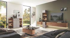 Massivholzwohnwand abgesetzt mit Titan. Tolle Kombinationsmöglichkeiten von Wohnwand, Sideboard, Couchtisch. So verwandeln Sie Ihr Wohnzimmer zum echten Hingucker. #moebelhaus#wohnzimmer#wohnwand#moebel#interior#wohnidee#wohnen#living#einrichten#einrichtung#design#livingroom#meinwohlfühlort#komfortwohnen#homesweethome#inneneinrichtung#einrichtung#interiorinspo#furniture#design#livingroom#interiorhome #wohnwand #sideboard #hängeregal #couchtisch #Vitrine #lowboard Living Area, Living Spaces, Queen Murphy Bed, Wood And Metal, Home Improvement, Dreaming Of You, This Is Us, Iron, Furniture
