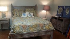 Tarpon design queen bed with matching night stands and chest or drawers. On display at Lisa Mayo's design Center , by Sinclair Custom Woodworks.