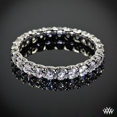 """Eternity band, This gorgeous """"U-Prong"""" Full Eternity Diamond Wedding Ring has been customized to hold 1.70ctw A CUT ABOVE ® Hearts and Arrows Diamond Melee."""