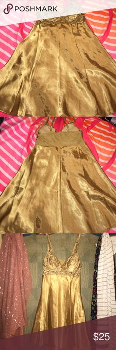 Sexy Victoria's Secret Gold nightie size small Victoria's Secret nightie, gold, super soft satiny feel, very sexy , has removable padding in bra, a/b cup,great condition, older style🚬🐱🏡💖accepting reasonable offers Victoria's Secret Intimates & Sleepwear Chemises & Slips