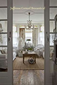 ♥ Shabby chic, love the floor, entry doors, shutters/dividers & the stainless glass windows!