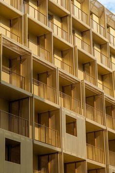 Golden boxes fronted by balconies make up the exterior of this student housing block in Paris