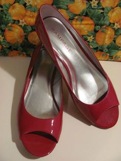 This hot little number from Rampage     will satisfy your every style craving    RAMPAGE    WOMENS RED PATENT LEATHER    WEDGE PUMPS    SIZE 9.5M    EXCELLENT CONDITION    FOR PREOWNED    SMALL MARKS ON WEDGE    DOES NOT EFFECT THE    WEAR & TEAR OF THESE SHOES    PEEK A BOO TOE    1.5 IN WEDGE    VERY CHIC & STYLISH    VERY COMFY    LIGHTLY PADDED INSOLE     WONDERFUL ADDITION    TO YOUR WARDROBE