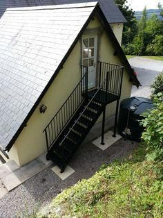 External metal staircase to a garage loft conversion - Modern Garage Guest House, Garage Loft, Outdoor Wood Fireplace, Detached Garage Designs, Staircase Outdoor, Outside Stairs, External Staircase, Sloped Backyard, Exterior Stairs