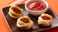 These meatball mummy bites are the perfect kid-size appetizer.  Great to serve at your next Halloween party!