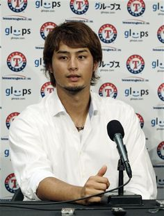 Texas Rangers pitcher Yu Darvish, of Japan, speaks at a news conference after the Chicago White Sox defeated the Texas Rangers 2-1 in a baseball game in Chicago, Thursday, July 5, 2012. Darvish is the American League's winner of the fan vote for the 2012 MLB All-Star Game. (AP Photo/Nam Y. Huh)