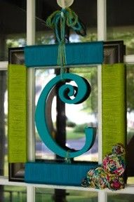 picture frame wrapped in yarn with an initial for the front door