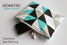 Use small fabric scraps to create geometric patchwork for this simple zippered pouch. Get the full tutorial to make a Geometric Zipper Pouch.