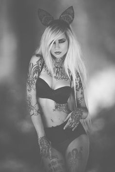 If I could look like anyone I would pick Sara Fabel! She is fit. I love her tattoos, her whole look & she loves cats too!! ... She could tattoo me any day too! Love her work!