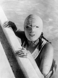 Picture of a latex whole-head swimming hood from 1928, Netherlands, designed to keep a woman's face pale and smooth on the sunniest of days.