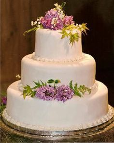 Love this simple DIY cake. The flowers are the perfect colors. This site has DIY wedding cake advice, if your crazy enough to consider doing it yourself. :)