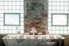 cake table - photo by Geneoh Photography http://ruffledblog.com/converted-train-station-wedding
