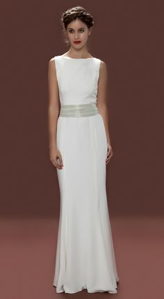 Lara Hannah Airlia Dress    Classic, simplistic and elegant are words that have been used to describe the Airlia Wedding Dress.This vintage inspired high-neck wedding dress is made from silk crepe and lined with luxurious silk has a Grecian feel. The beaded Airlia belt which is fully detachable is made from individually hand stitched clear bugle beads embellished onto a silk georgette base creating the right amount of glitz.