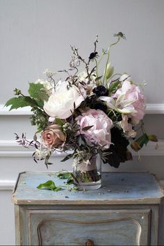 The contrast of colors and textures works great with the large, classic flowers to create interest.