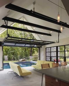 Open Plan Pool House design isan unusual home addition project carried out by experts from the American architectural studio Randall Mars Architects. The pool house design connects main home interio Indoor Outdoor Pools, Indoor Swimming Pools, Outdoor Rooms, Outdoor Living, Lap Pools, Outdoor Patios, Outdoor Kitchens, Pool House Designs, Modern House Design