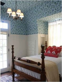 bedroom with blue floral paper