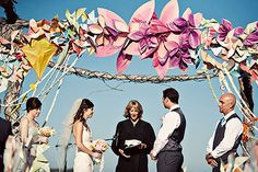 We'll never have the time to do this, but I do love the big colourful paper flowers. What a fun wedding arch!