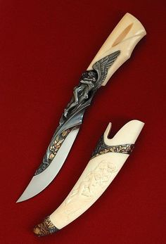 """Arpad Bojtos - Name: """"Amor and Psyche"""" Materials: Blade: 440 C Handle: fossil walrus ivory Sheath: ivory, silver, gold car] Description: Full carved integral, inlayed by gold, copper and titanium. The total lenght: 26 CMs. Pretty Knives, Cool Knives, Swords And Daggers, Knives And Swords, Lame Damas, Beil, Dagger Knife, Knife Art, Handmade Knives"""