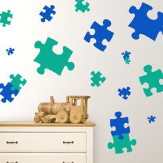 These Puzzle Piece wall decals will create a fun mood in your child's playroom or nursery. Bringing home baby but bored with your walls? Never fear, nursery wall decals are here! With the Puzzle Piece