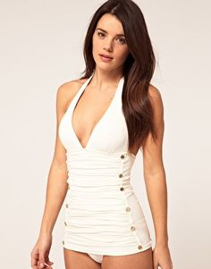 Ruched halter swimsuit by Juicy Couture. Featuring a plunging v-neckline with soft triangle cups, self-tie halterneck fastening, a ruched panel to the front with a double breasted gold-tone button design and longline fit.