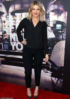 Back in black: Ali Fedotowsky looked beautiful in an all black outfit including trousers, top and studded heels
