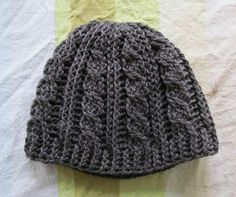 Cable Hat by Sarah Arnold - another great cable crochet beanie pattern. This pattern is available as a free Ravelry download.  Note this project (and pic)  missoj